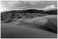Dunes and Sangre de Cristo mountains at dusk. Great Sand Dunes National Park, Colorado, USA. (black and white)