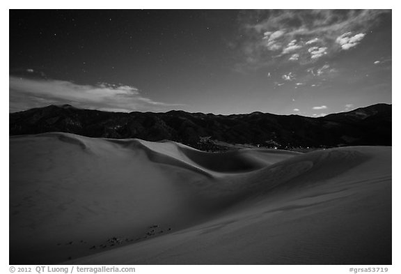 Dunes and mountains at night. Great Sand Dunes National Park and Preserve (black and white)