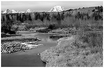 Stream, with Mt Moran emerging from ridige, late fall. Grand Teton National Park, Wyoming, USA. (black and white)