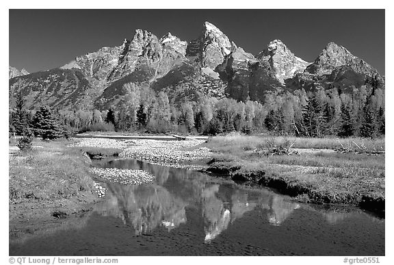 Grand Teton and fall colors reflected at Schwabacher landing. Grand Teton National Park, Wyoming, USA.