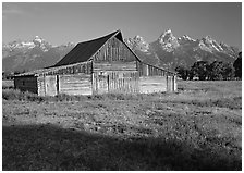 Historic Barn and Teton range, morning. Grand Teton National Park, Wyoming, USA. (black and white)
