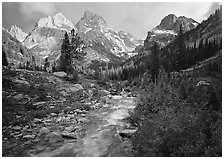 Valley, Cascade creek and Teton range with storm light. Grand Teton National Park, Wyoming, USA. (black and white)