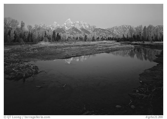 Teton range reflected in water at Schwabacher Landing, sunrise. Grand Teton National Park (black and white)