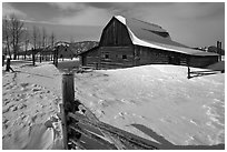 Historic Mormon Row homestead in winter. Grand Teton National Park, Wyoming, USA. (black and white)