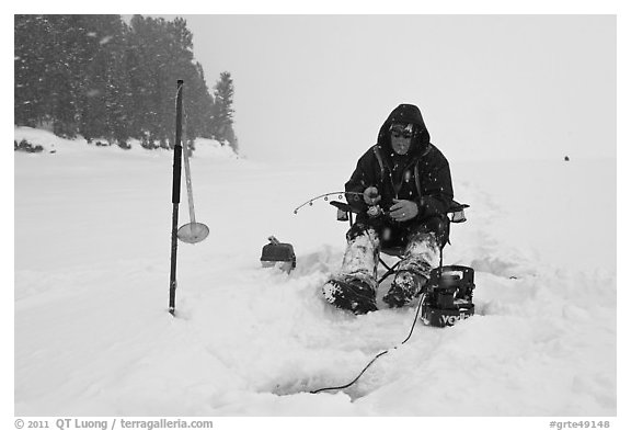 Ice fisherman in white-out, Jackson Lake. Grand Teton National Park (black and white)