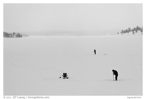 Jackson Lake in winter with ice fishermen. Grand Teton National Park (black and white)