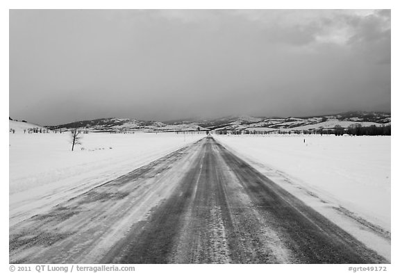 Road in winter at dusk, Gross Ventre valley. Grand Teton National Park (black and white)