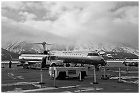 Regional jet and fuel truck, Jackson Hole Airport. Grand Teton National Park, Wyoming, USA. (black and white)