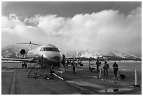Passengers boarding aircraft, Jackson Hole Airport, winter. Grand Teton National Park, Wyoming, USA. (black and white)