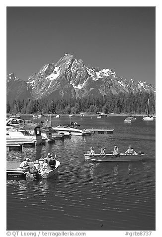 Boaters at Colter Bay marina with Mt Moran in the background, morning. Grand Teton National Park (black and white)