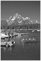 Boaters at Colter Bay marina with Mt Moran in the background, morning. Grand Teton National Park, Wyoming, USA. (black and white)