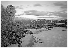 Rock tower and neve at sunset, Rock Cut. Rocky Mountain National Park, Colorado, USA. (black and white)