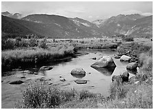 Creek, boulders, and meadow surrounded by mountains, autumn. Rocky Mountain National Park, Colorado, USA. (black and white)
