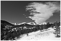 Partly thawed meadow, snowy range, and cloud. Rocky Mountain National Park ( black and white)