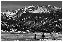 Thawing meadow and snowy peaks, late winter. Rocky Mountain National Park ( black and white)