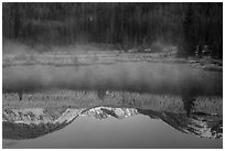 Mist and Never Summer Mountains reflection. Rocky Mountain National Park, Colorado, USA. (black and white)