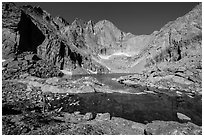 Park visitor Looking, Chasm Lake. Rocky Mountain National Park, Colorado, USA. (black and white)