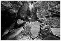 Waterfall in narrow gorge. Rocky Mountain National Park ( black and white)