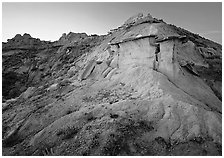 Badlands and caprock formation at sunset, South Unit. Theodore Roosevelt National Park, North Dakota, USA. (black and white)