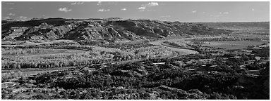 Wide valley with river and aspens in autumn color. Theodore Roosevelt National Park (Panoramic black and white)