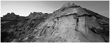 Badlands scenery with caprocks. Theodore Roosevelt National Park (Panoramic black and white)