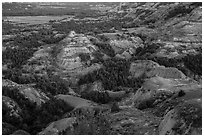 Badlands in summer at dusk. Theodore Roosevelt National Park ( black and white)