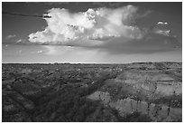 Storm cloud and badlands at sunset, South Unit. Theodore Roosevelt National Park ( black and white)