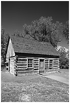 Roosevelt's Maltese Cross Cabin, afternoon. Theodore Roosevelt National Park, North Dakota, USA. (black and white)