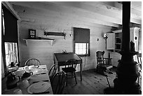 Dining room of Theodore Roosevelt's Maltese Cross Cabin. Theodore Roosevelt National Park ( black and white)