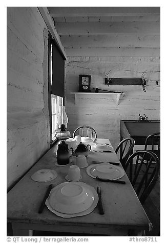 Dining table inside Roosevelt's Maltese Cross Cabin. Theodore Roosevelt National Park (black and white)