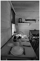 Dining table inside Roosevelt's Maltese Cross Cabin. Theodore Roosevelt National Park, North Dakota, USA. (black and white)