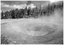Steam out of Beauty pool in Upper geyser basin. Yellowstone National Park, Wyoming, USA. (black and white)