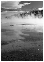Great prismatic springs, thermal steam, and hill,  Midway geyser basin. Yellowstone National Park, Wyoming, USA. (black and white)