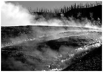 Steam and hill, Midway geyser basin. Yellowstone National Park, Wyoming, USA. (black and white)