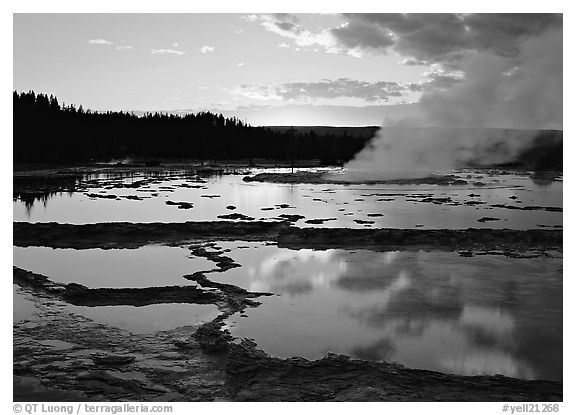 Great Fountain Geyser with residual steam at sunset. Yellowstone National Park (black and white)
