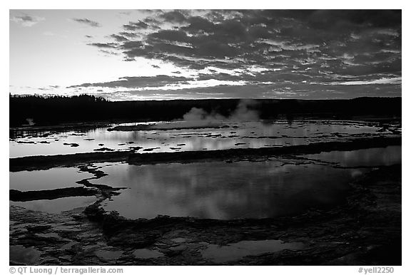 Great Fountain geyser and colorful clouds at sunset. Yellowstone National Park (black and white)