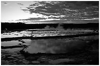 Great Fountain geyser and colorful clouds at sunset. Yellowstone National Park ( black and white)