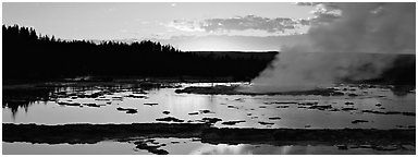 Steam rising in geyser pool at sunset. Yellowstone National Park (Panoramic black and white)