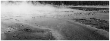 Steam rising from multi-colored thermal springs. Yellowstone National Park (Panoramic black and white)