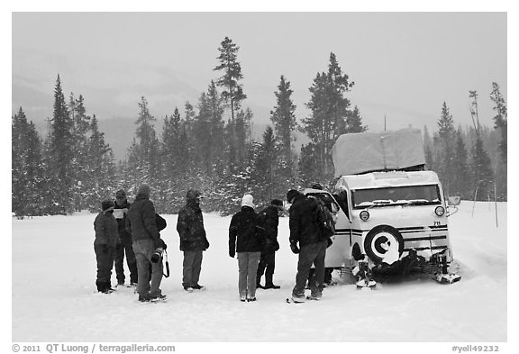 Travelers boarding snow bus. Yellowstone National Park (black and white)