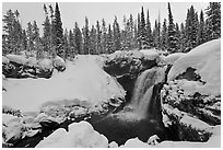 Snowy landscape with waterfall. Yellowstone National Park, Wyoming, USA. (black and white)