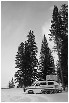 Snowcoach and trees. Yellowstone National Park, Wyoming, USA. (black and white)