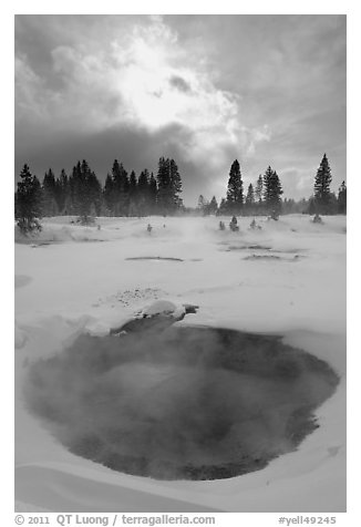 Thermal pool and dark clouds, winter. Yellowstone National Park (black and white)