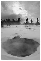 Thermal pool and dark clouds, winter. Yellowstone National Park, Wyoming, USA. (black and white)
