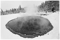 Visitor at Morning Glory Pool, winter. Yellowstone National Park, Wyoming, USA. (black and white)