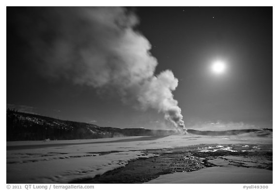 Old Faithful Geyser eruption and moon. Yellowstone National Park (black and white)