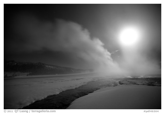 Run-off and geyser, steam obscuring moon, Old Faithful. Yellowstone National Park (black and white)