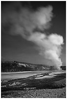 Plume, Old Faithful geyser, winter night. Yellowstone National Park, Wyoming, USA. (black and white)
