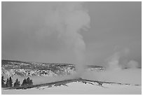 Old Faithful geyser plume in winter. Yellowstone National Park, Wyoming, USA. (black and white)