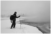 Skier at the edge of thermal pool. Yellowstone National Park, Wyoming, USA. (black and white)
